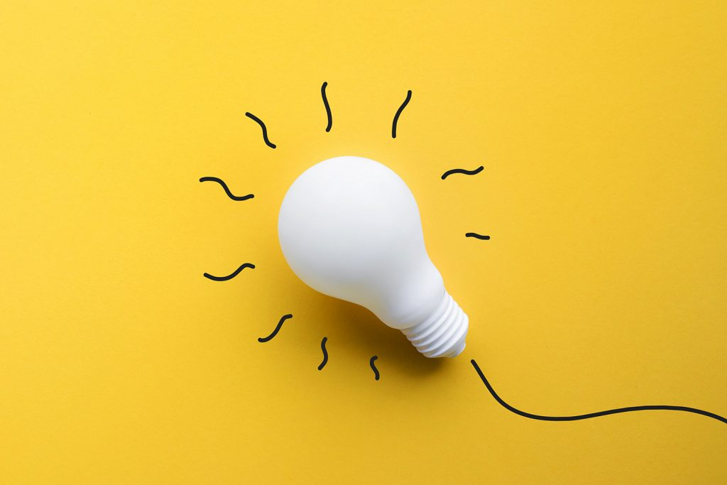 White lightbulb on pastel color background.Ideas creativity
